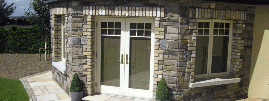 stone faces sunroom with cream brick coins and sandstone paving